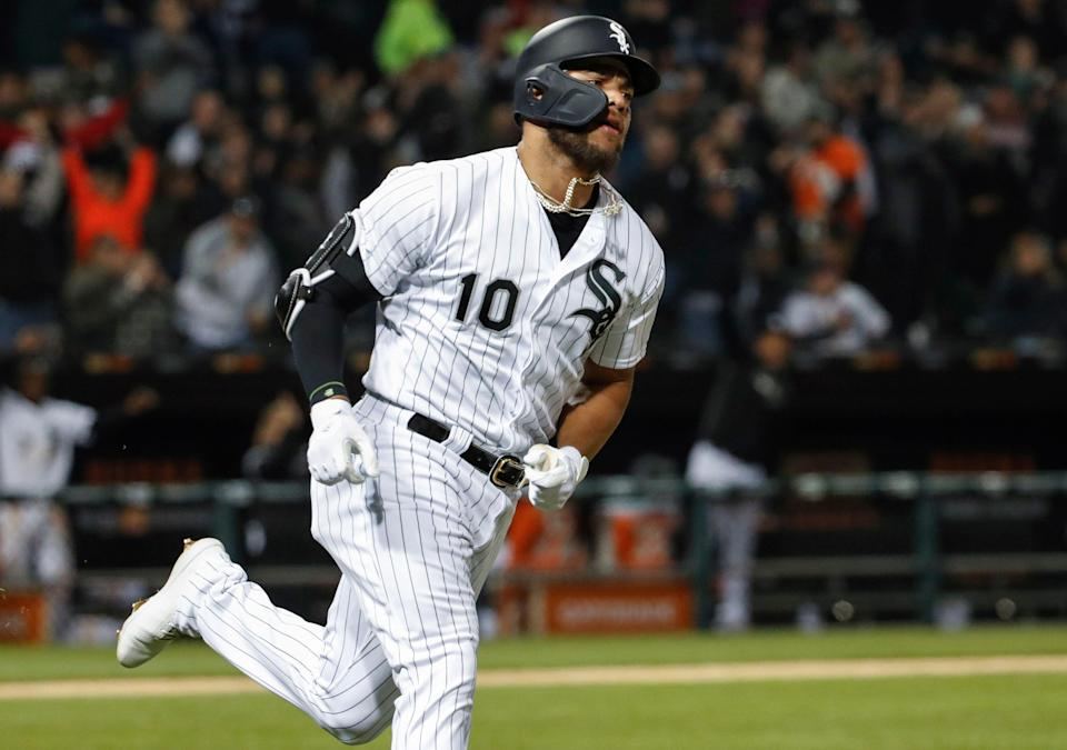 Chicago White Sox's Yoan Moncada rounds the bases after hitting a solo home run off of Kansas City Royals starting pitcher Jorge Lopez during the fifth inning of a baseball game, Tuesday, April 16, 2019, in Chicago. (AP Photo/Kamil Krzaczynski)