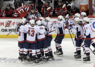 The Washington Capitals celebrate with Alex Ovechkin (8) after he scored his 700th career goal during the third period of an NHL hockey game against the New Jersey Devils Saturday, Feb. 22, 2020, in Newark, N.J. (AP Photo/Bill Kostroun)