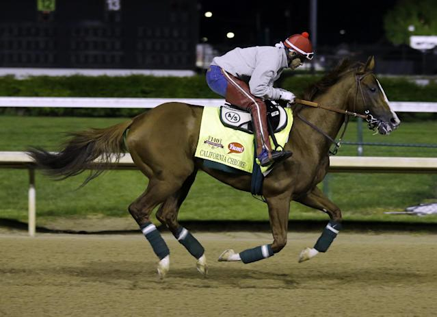 Exercise rider William Delgado takes Kentucky Derby entrant California Chrome for a morning workout during a morning workout at Churchill Downs Friday, May 2, 2014, in Louisville, Ky. (AP Photo/Morry Gash)