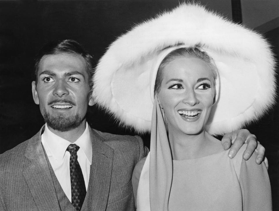 Actor Neil Connery, the brother of James Bond star Sean Connery, poses with actress Daniela Bianchi at a press conference for the upcoming Bond spoof 'Operation Kid Brother', aka 'OK Connery', Italy, 25th November 1966. (Photo by Keystone/Hulton Archive/Getty Images)