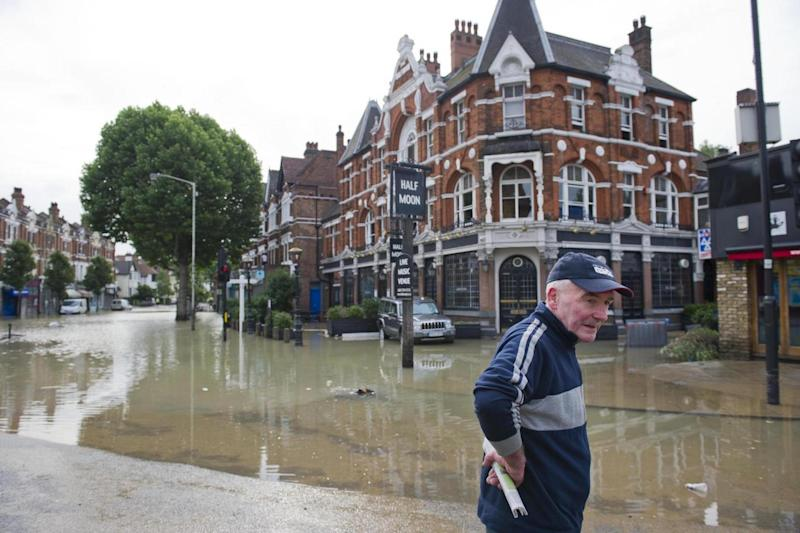 Transformed: the Half Moon in Herne Hill during the 2013 flood (John Nguyen/JNVisuals)