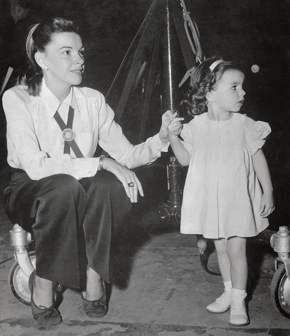 <p>Here, she visits her mother during recordings of Rodgers and Hart's <em>Words and Music </em>circa 1948. Her first acting role would come when she was just 3; she appeared in the final scene of her mother's film, <em>In the Good Old Summertime. </em></p>