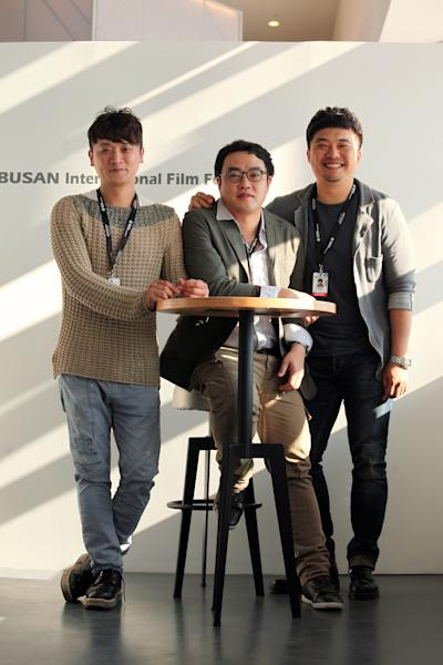 "In this Oct.4, 2013 photo, South Korean producer Yoon Ki Ho, left, director Kim Taeyun, center, and producer Park Sung-il of the movie ""Another Family"" pose during an interview at Busan Cinema Center in Busan, South Korea. ""Another Family,"" which premiered during the 18th Busan International Film Festival ending on Saturday, is a fictional account based on the story of Hwang Yu-mi, who died at the age of 23 from leukemia in 2007, four years after joining Samsung's memory chip factory in Yongin, Korea. The title resonates widely in South Korea because it is a well-known Samsung advertising slogan. (AP Photo/Woohae Cho)"