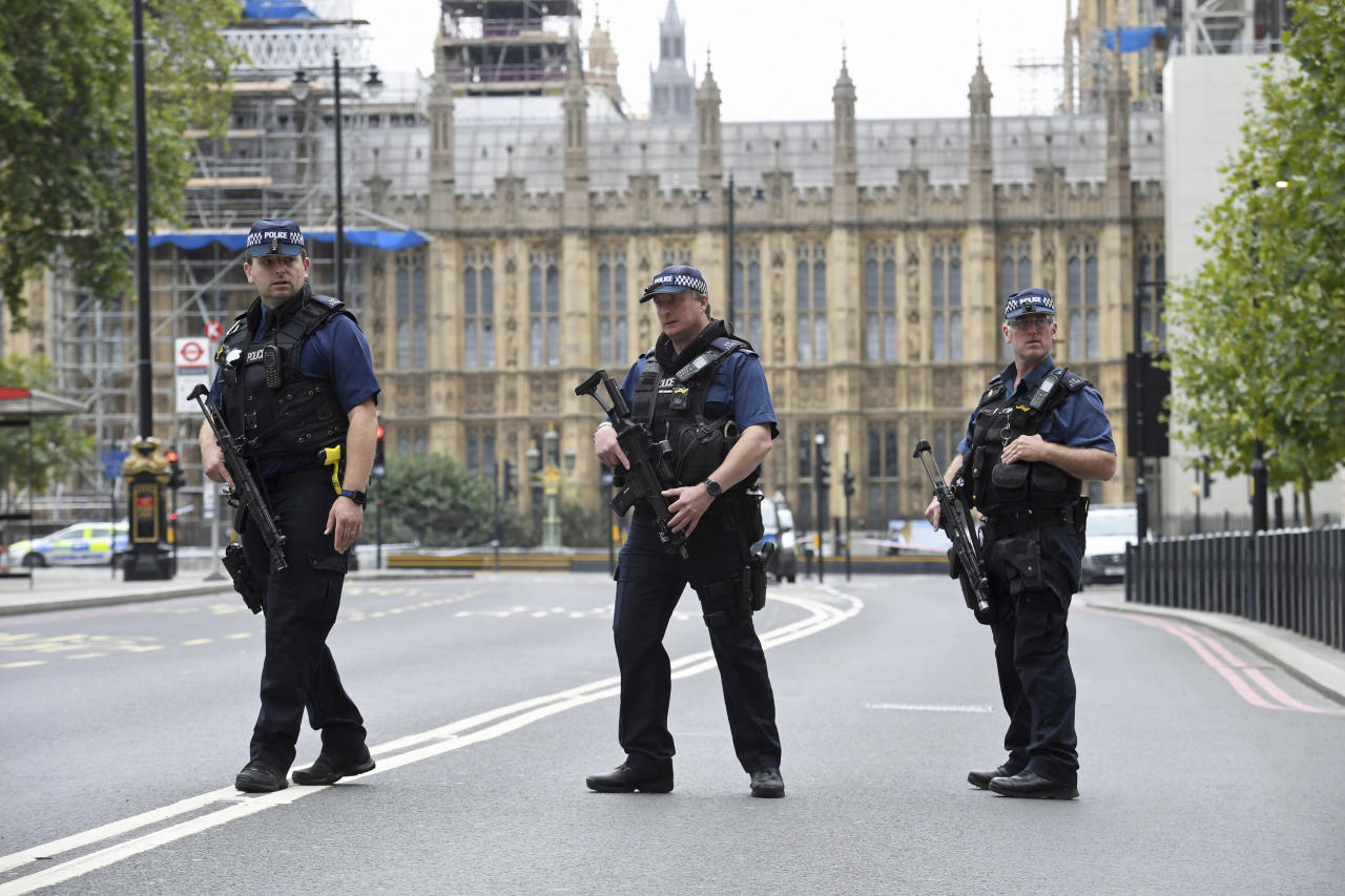 <p>Armed police on Victoria Embankment in Westminster, after a car crashed into security barriers outside the Houses of Parliament, in London, Tuesday, Aug. 14, 2018. (Photo: Stefan Rousseau/PA via AP) </p>