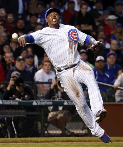 Chicago Cubs third baseman Luis Valbuena fields a ground ball hit for a single by St. Louis Cardinals' Yadier Molina during the fourth inning of a baseball game, Tuesday, May 7, 2013, in Chicago. (AP Photo/Charles Rex Arbogast)