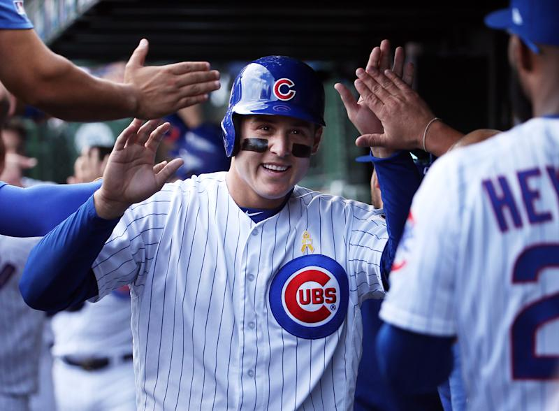 Chicago Cubs first baseman Anthony Rizzo (44) is congratulated in the dugout after scoring on a home run by Chicago Cubs right fielder Nicholas Castellanos (6) in the first inning against the Pittsburgh Pirates on Friday, Sept. 13, 2019 at Wrigley Field in Chicago, Ill. (Terrence Antonio James/Chicago Tribune/Tribune News Service via Getty Images)