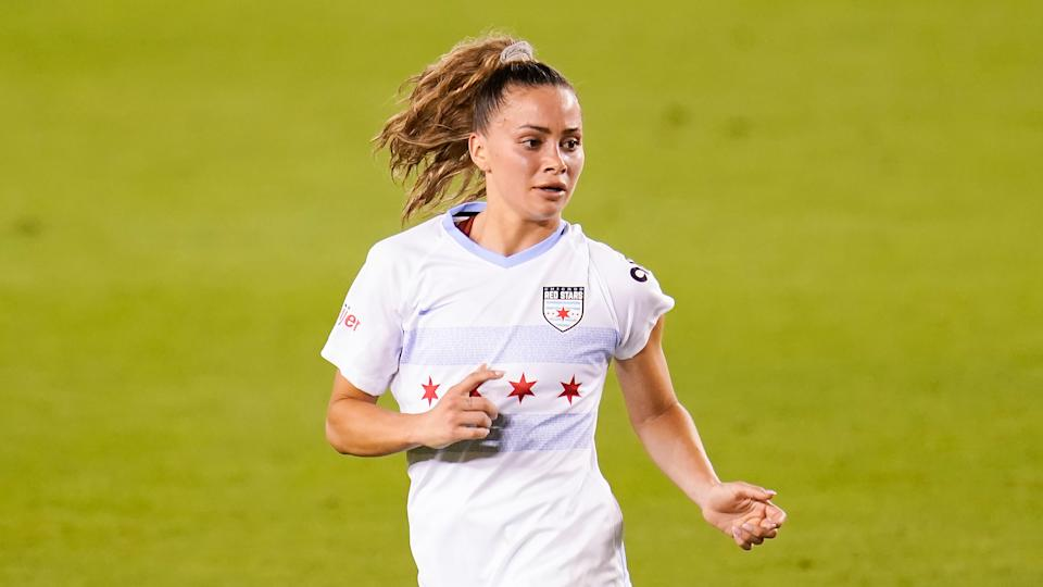 Chicago Red Stars defender Sarah Gorden (11) runs upfield during an NWSL Challenge Cup soccer match, Friday, April 9, 2021, in Houston. (AP Photo/Matt Patterson)