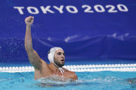Greece's Ioannis Fountoulis celebrates after scoring a goal against the United States during a preliminary round men's water polo match at the 2020 Summer Olympics, Monday, Aug. 2, 2021, in Tokyo, Japan. (AP Photo/Mark Humphrey)
