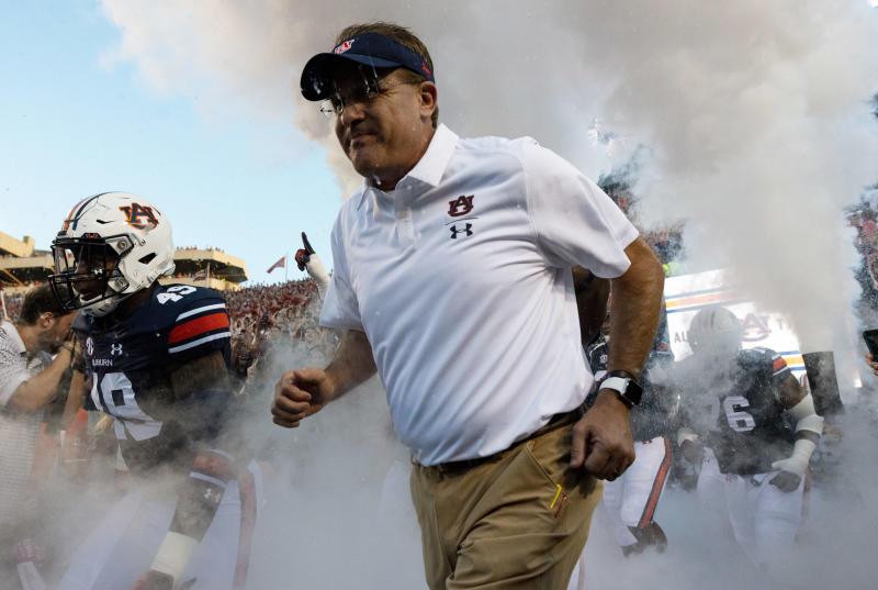 FILE - In this Saturday, Sept. 8, 2018, file photo, Auburn coach Gus Malzahn takes the field for the team's NCAA college football game against Alabama State, in Auburn, Ala. Malzahn, who just the season before seemed to be in a precarious position with Auburn, received a $49 million, seven-year contract that makes him the fifth-highest paid coach in college football this season, according to USA Today's salary database. (AP Photo/Vasha Hunt, File)