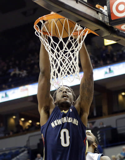 New Orleans Pelicans' Al-Farouq Aminu dunks in the first quarter of an NBA basketball game against the Minnesota Timberwolves, Wednesday, Jan. 29, 2014, in Minneapolis. (AP Photo/Jim Mone)