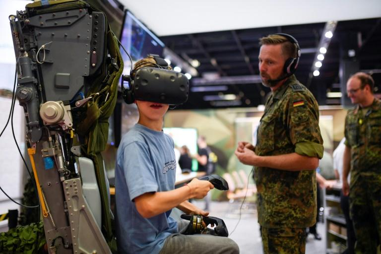 Dozens of young gamers visited Germany's army stall to test out a helicopter simulator (AFP Photo/Ina FASSBENDER)