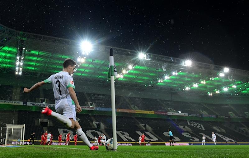 Bundesliga CEO Christian Seifert suggested Thursday that COVID-19 could keep fans out of German soccer stadiums well into 2021. (Jorg Schüler/Getty)