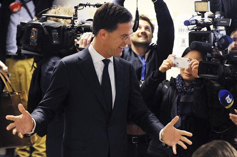 Dutch Prime Minister Mark Rutte jokes around after casting his vote: AP
