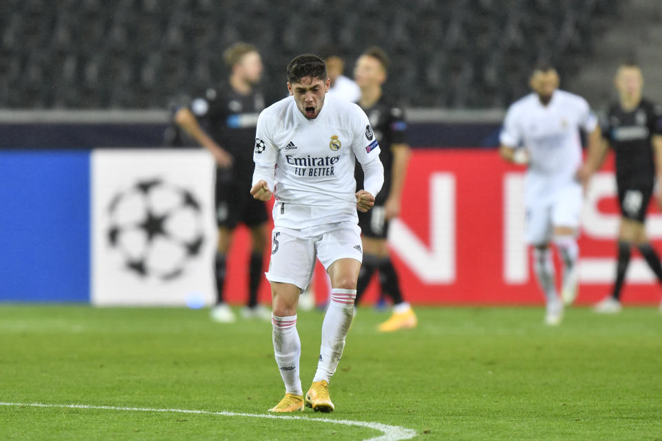 Real Madrid's Federico Valverde celebrates after Real Madrid's Casemiro scored his side's second goal during the Champions League group B soccer match between Borussia Moenchengladbach and Real Madrid at the Borussia Park in Moenchengladbach, Germany, Tuesday, Oct. 27, 2020. (AP Photo/Martin Meissner)