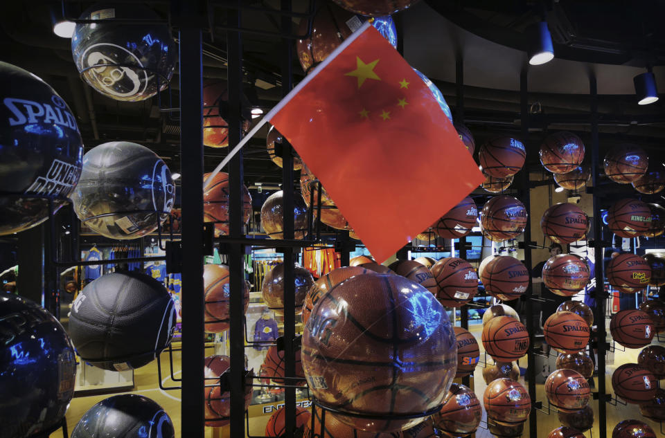 China's flag hangs in the NBA store amid basketballs.