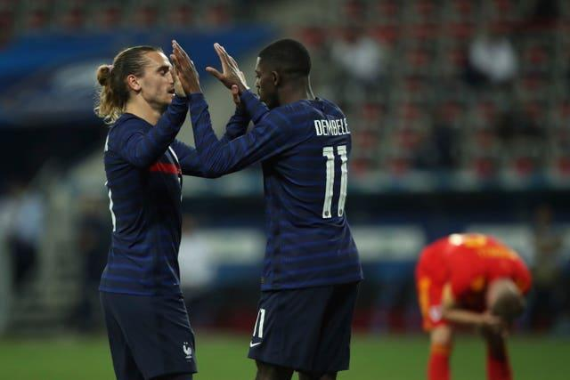 Ousmane Dembele celebrates with France's Antoine Griezmann after scoring his side's third goal