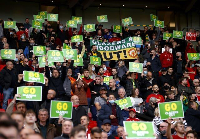 Manchester United fans hold up anti-Glazer placards ahead of the club's final home game of the season. Around 10,000 supporters attended the 1-1 draw with relegated Fulham. Despite ongoing opposition to United's owners, there was no significant demonstration prior to kick-off
