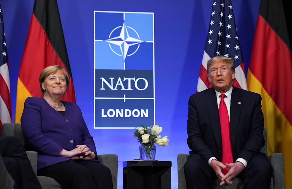 U.S. President Donald Trump and Germany's Chancellor Angela Merkel hold a bilateral meeting at the sidelines of the NATO summit in Watford, Britain, December 4, 2019. REUTERS/Kevin Lamarque