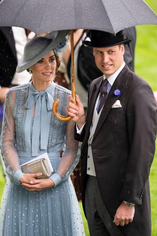 <p>On the first day of Royal Ascot, Prince William helpfully shields his wife from the downpour.</p>