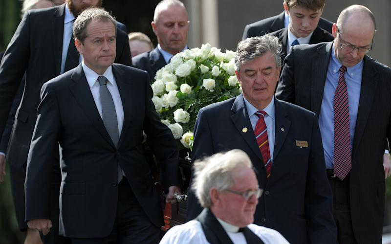 Mr Shorten (front left) carries the coffin of his mother Dr Ann Shorten with fellow pallbearers including brother Robert (R) at Xavier College Chapel in Melbourne, Tuesday, April 15, 2014.Dr Ann Shorten died on April 6. (AAP Image/Julian Smith) NO ARCHIVING