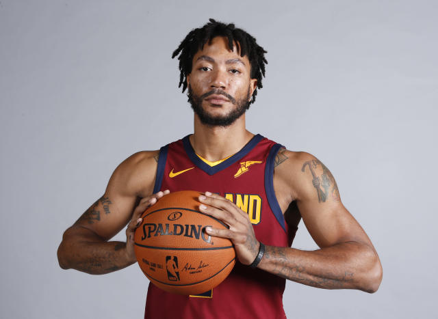FILE - In this Sept. 25, 2017, file photo, Cleveland Cavaliers' Derrick Rose poses for a portrait during the NBA basketball team media day, in Independence, Ohio. Estranged point guard Derrick Rose has returned to the Cavaliers. The former NBA MVP left the team on Nov. 9 after being sidelined with a sprained left ankle. His latest injury had Rose contemplating whether to continue playing, but the Cavs said Monday, Dec. 4, 2017, that Rose has rejoined the team to resume treatment and rehabilitation. (AP Photo/Ron Schwane, File)