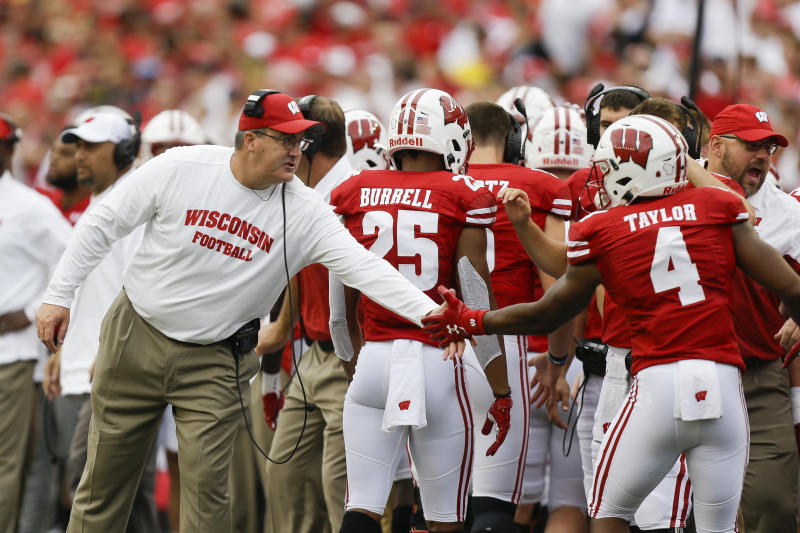 Wisconsin head coach Paul Chryst congratulates wide receiver A.J. Taylor after a Wisconsin touchdown during the first half of an NCAA college football game Saturday, Sept. 21, 2019, in Madison, Wis. Wisconsin won 35-14. (AP Photo/Andy Manis)