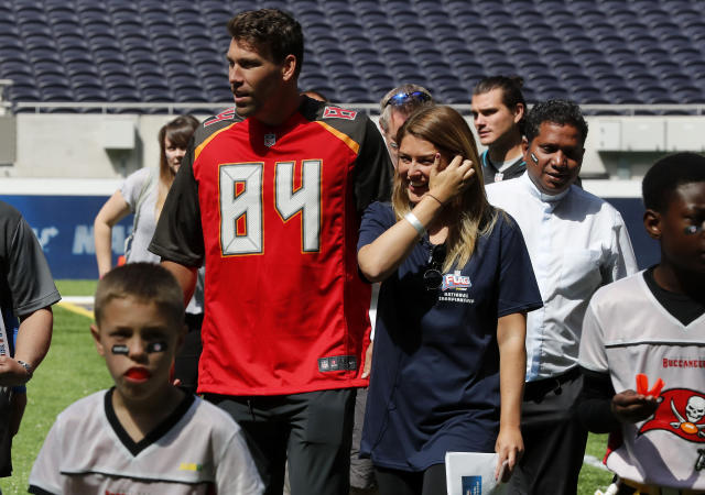 NFL player Cameron Brate of Tampa Bay Buccaneers leaves the pitch after coaches a young team during the final tournament for the UK's NFL Flag Championship, featuring qualifying teams from around the country, at the Tottenham Hotspur Stadium in London, Wednesday, July 3, 2019. The new stadium will host its first two NFL London Games later this year when the Chicago Bears face the Oakland Raiders and the Carolina Panthers take on the Tampa Bay Buccaneers. (AP Photo/Frank Augstein)
