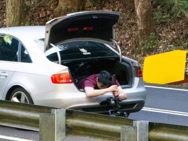 A NSW Police chief inspector has described the stunt, pictured is the man out of the boot, as 'dangerous and selfish'.