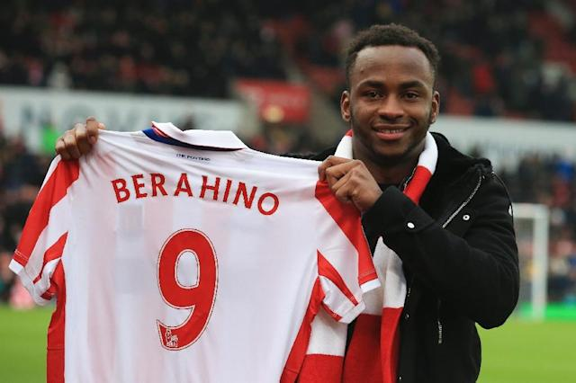 Stoke City's new signing Saido Berahino poses with his No.9 shirt ahead of the English Premier League match against Manchester United in Stoke on January 21, 2017 (AFP Photo/Lindsey PARNABY)