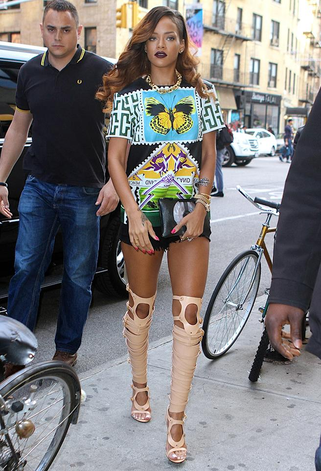 Rihanna wore a stunningly colorful butterfly dress and strapped knee high boots while leaving her NYC hotel.