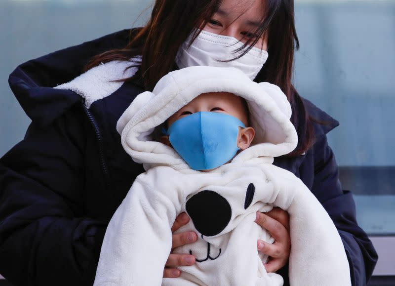 A family members wearing protective masks is seen in Sapporo, Hokkaido