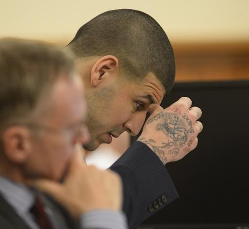 Former New England Patriots football player Aaron Hernandez listens during his murder trial at the Bristol County Superior Court in Fall River, Mass., on Friday, April 3, 2015. Hernandez is charged with killing Odin Lloyd. (AP Photo/CJ Gunther, Pool)