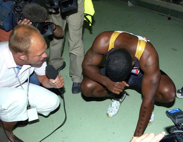 Justin Gatlin of the United States is interviewed by journalists after the breaking the Men's 100 meter world record at the Qatar Grand Prix in Doha, Qatar Friday May 12, 2006. Gatlin, the Olympic Champion, broke the record with a time of 9.76 seconds lowering the mark of 9.77 seconds set by Jamaica's Asafa Powell in Athens in June 2005. (AP Photo/Abdul Basit)
