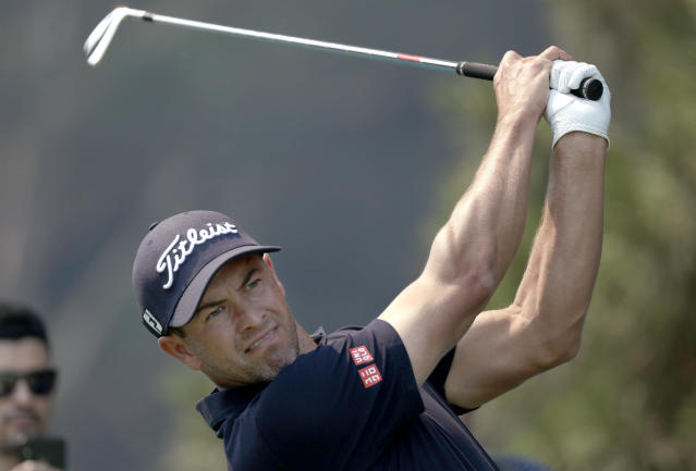 Australia's Adam Scott tees off on the 13th during the Australian Open Golf Pro-AM in Sydney, Wednesday, Dec. 4, 2019. The Australian Open begins Thursday. (AP Photo/Rick Rycroft)