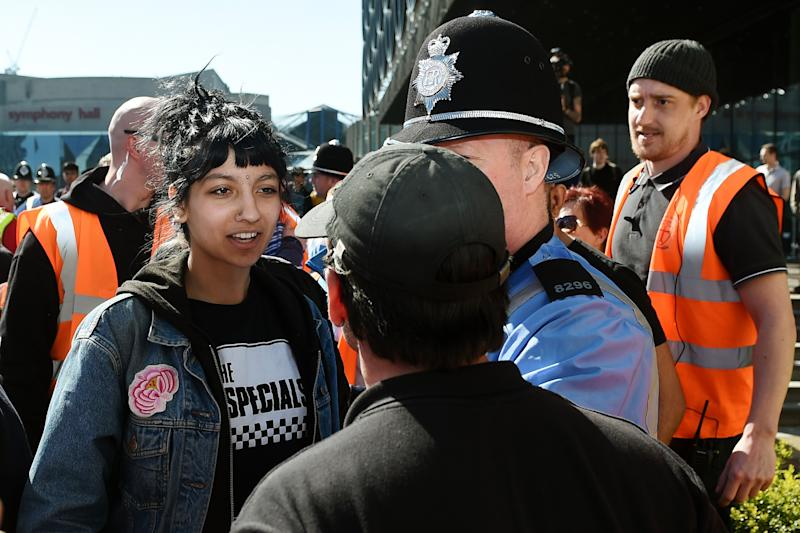 Saffiyah Khan (left) confronts English Defence League (EDL) protester Ian Crossland during a demonstration in the city of Birmingham, in the wake of the Westminster terror attack. (Photo by Joe Giddens/PA Images via Getty Images)