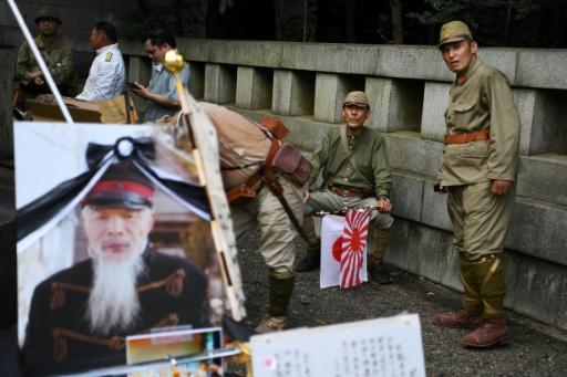 Re-enactors clad in Imperial Japanese Army uniforms gather at the Yasukuni shrine on the 74th anniversary of Japan's surrender during World War II, in Tokyo
