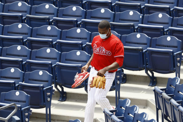 Philadelphia Phillies' Ramon Rosso walks through the stands during baseball practice at Citizens Bank Park, Tuesday, July 7, 2020, in Philadelphia. (AP Photo/Matt Slocum)