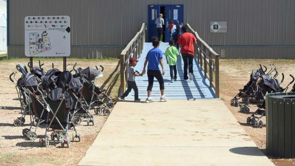 PHOTO: Immigrants walk into a building at South Texas Family Residential Center in Dilley, Texas, Aug. 9, 2018. (Charles Reed/U.S. Immigration and Customs Enforcement/AP, FILE)