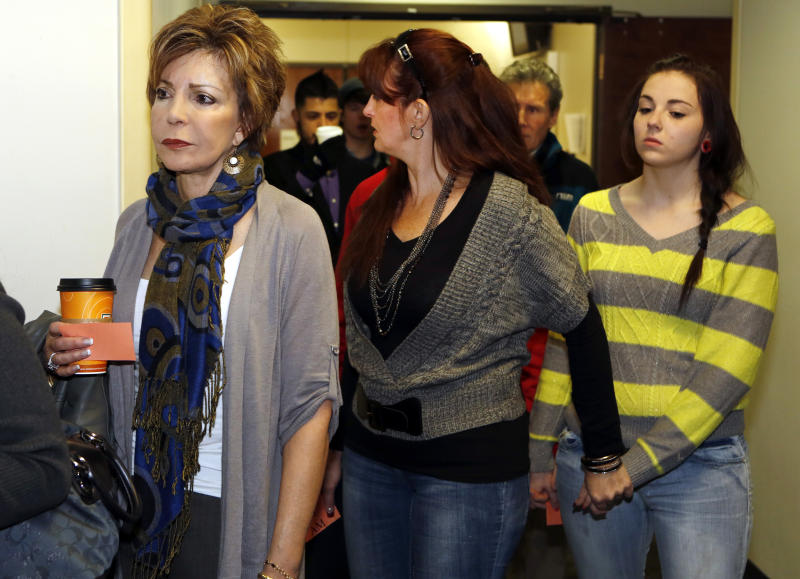 Family members and victims line up to get into court for a preliminary hearing for Aurora theater shooting suspect james Holmes at the courthouse in Centennial, Colo., on Monday, Jan. 7, 2013.  Holmes is charged with more than 160 counts, including murder and attempted murder after a bloody rampage in a Colorado movie theater left 12 people dead.  (AP Photo/Ed Andrieski)