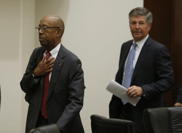 Ohio State University president Dr. Michael Drake, left, and university board of trustees chair Michael Gasser leave to go into executive session during a meeting of the trustees to discuss the future of NCAA college football coach Urban Meyer in Columbus, Ohio, Wednesday, Aug. 22, 2018. The board will meet in private to decide whether the superstar coach should be punished for the way he handled domestic-abuse allegations against a former assistant. (AP Photo/Paul Vernon)