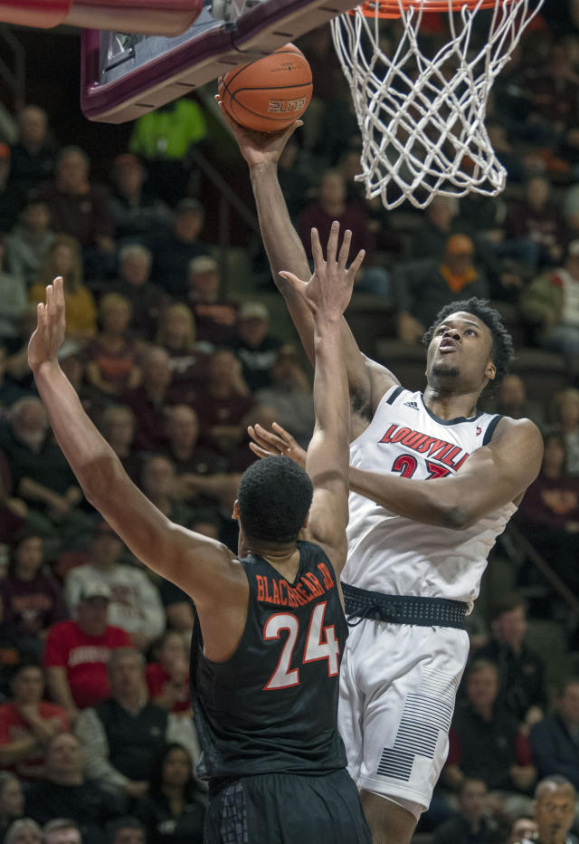 Louisville center Steven Enoch, right, goes up for a basket against Virginia Tech Hokies forward Kerry Blackshear Jr., left, during the first half of an NCAA college basketball game Monday, Feb. 4, 2019, in Blacksburg, Va. (AP Photo/Don Petersen)