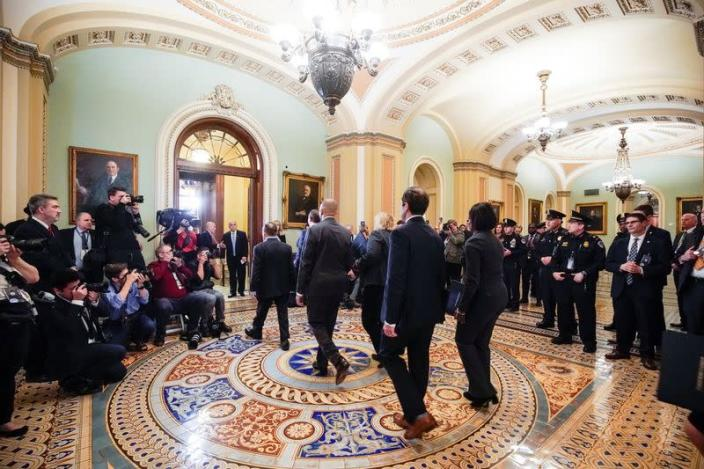 House managers arrive to deliver the articles of impeachment against Trump in Washington