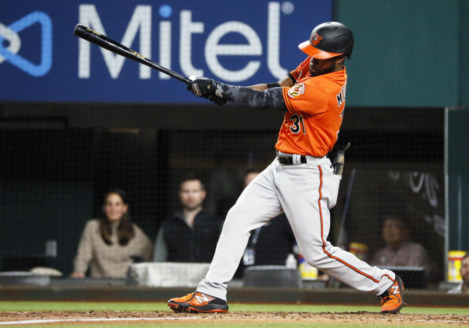 Baltimore Orioles' Cedric Mullins follows thru on an RBI single against the Texas Rangers during the seventh inning of a baseball game in Arlington, Texas, Saturday, April 17, 2021. (AP Photo/Ray Carlin)