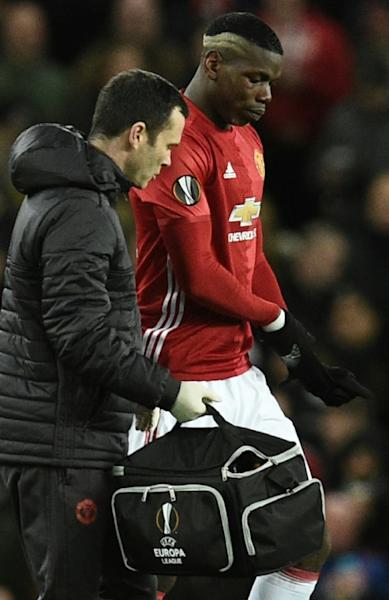 Manchester United's Paul Pogba (right) leaves the field after injuring his hamstring in the Europa League victory over FC Rostov at Old Trafford on March 16, 2017