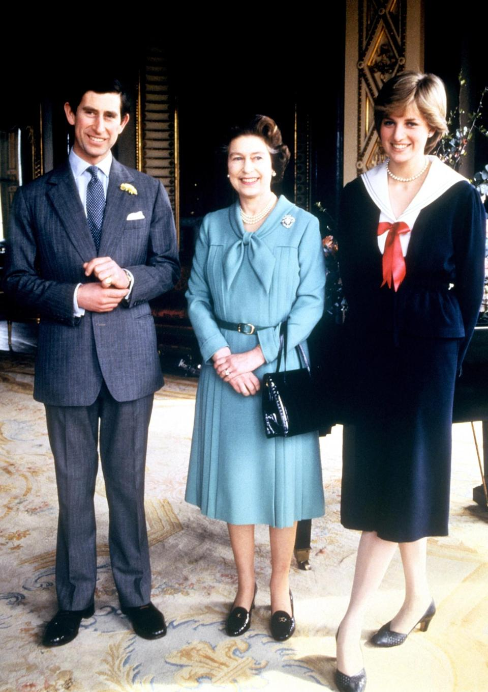 <p>Prince Charles and his then-fiancee Lady Diana Spencer meet The Queen at Buckingham Palace. (PA Archive) </p>