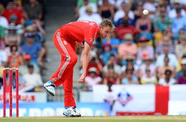 England's cricket team captain Stuart Broad delivers a ball during the first T20 match between England and West Indies at the Kensington Oval in Bridgetown on March 9, 2014. West Indies won the toss and elected to bat first. AFP PHOTO/Jewel Samad (Photo credit should read JEWEL SAMAD/AFP/Getty Images)