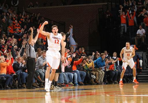 The crowd reacts with Virginia guard Joe Harris (12) after a last-minute 3-point basket during the first half of an NCAA college basketball game against Wake Forest on Wednesday, Jan. 8, 2014, in Charlottesville, Va. (AP Photo/Andrew Shurtleff)