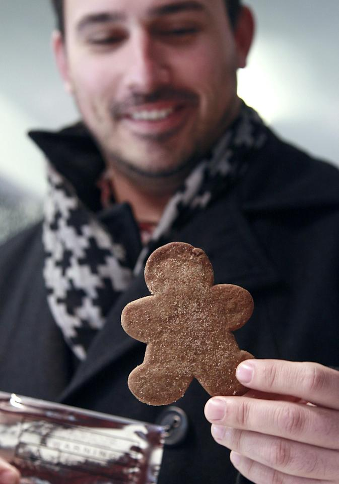 Jason Abrao, manager at The Apothecarium Medical Cannabis Dispensary, holds an edible marijuana gingerbread cookie at The Apothecarium in San Francisco, Thursday, Dec. 15, 2011. Medical marijuana dispensaries in the states where people can use pot with a doctor's recommendation are getting in the holiday spirit, holding canned food drives, stocking up on pumpkin and peppermint-infused edibles and offering customers specials on their favorite cannabis strains. (AP Photo/Jeff Chiu)
