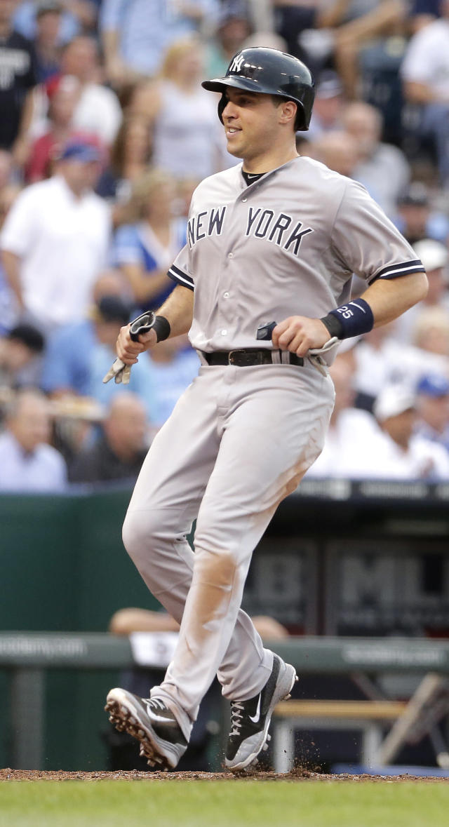 New York Yankees' Mark Teixeira runs home to score on a double by Brian McCann during the third inning of a baseball game against the Kansas City Royals, Friday, June 6, 2014, in Kansas City, Mo. (AP Photo/Charlie Riedel)