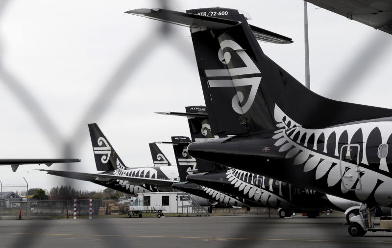 In this April 6, 2020, photo, Air New Zealand planes sit idle on the tarmac at Christchurch Airport, New Zealand. New Zealand has set itself an ambitious goal of not just containing the coronavirus, but eliminating it altogether. Experts believe the country could pull it off, thanks to its geography and decisive early actions by Prime Minister Jacinda Ardern, who has put the country into a strict lockdown. But whatever happens, the country will continue feeling the effects of the pandemic, which has hobbled its vital tourism industry. (AP Photo/Mark Baker)